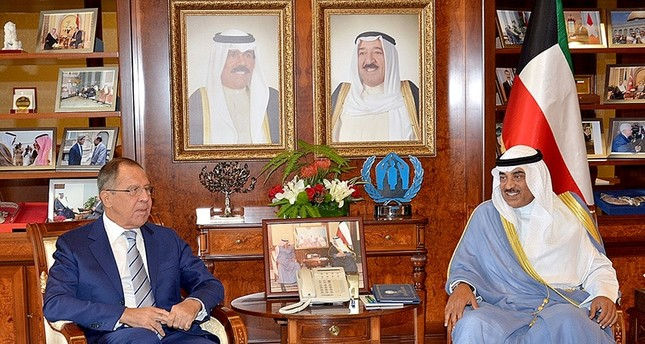 A handout photo provided by the Kuwaiti news agency KUNA on August 28, 2017 shows Kuwaiti Foreign Minister, Sheikh Sabah al-Khaled al-Sabah (R) meeting with his Russian counterpart Sergey Lavrov in Kuwait City (AFP Photo)