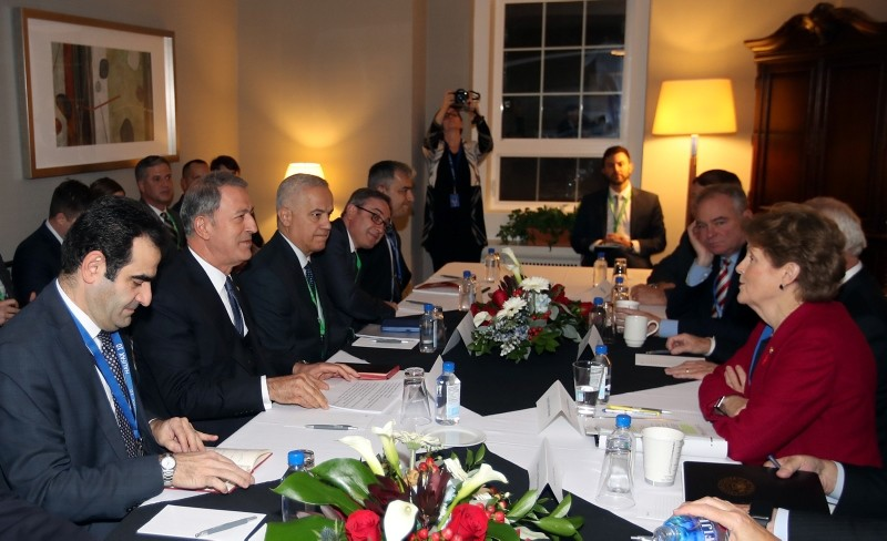 Defense Minister Hulusi Akar meeting with several U.S. senators on the sidelines of the Halifax International Security Forum in Halifax, Canada, Nov. 17, 2018. (AA Photo)