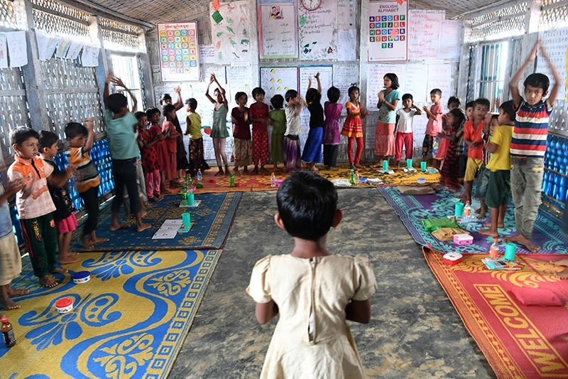 This photograph taken on October 7, 2017 shows Rohingya refugee children during a group activity at a school in Kutupalong refugee camp in the Bangladeshi district of Ukhia. (AFP Photo)