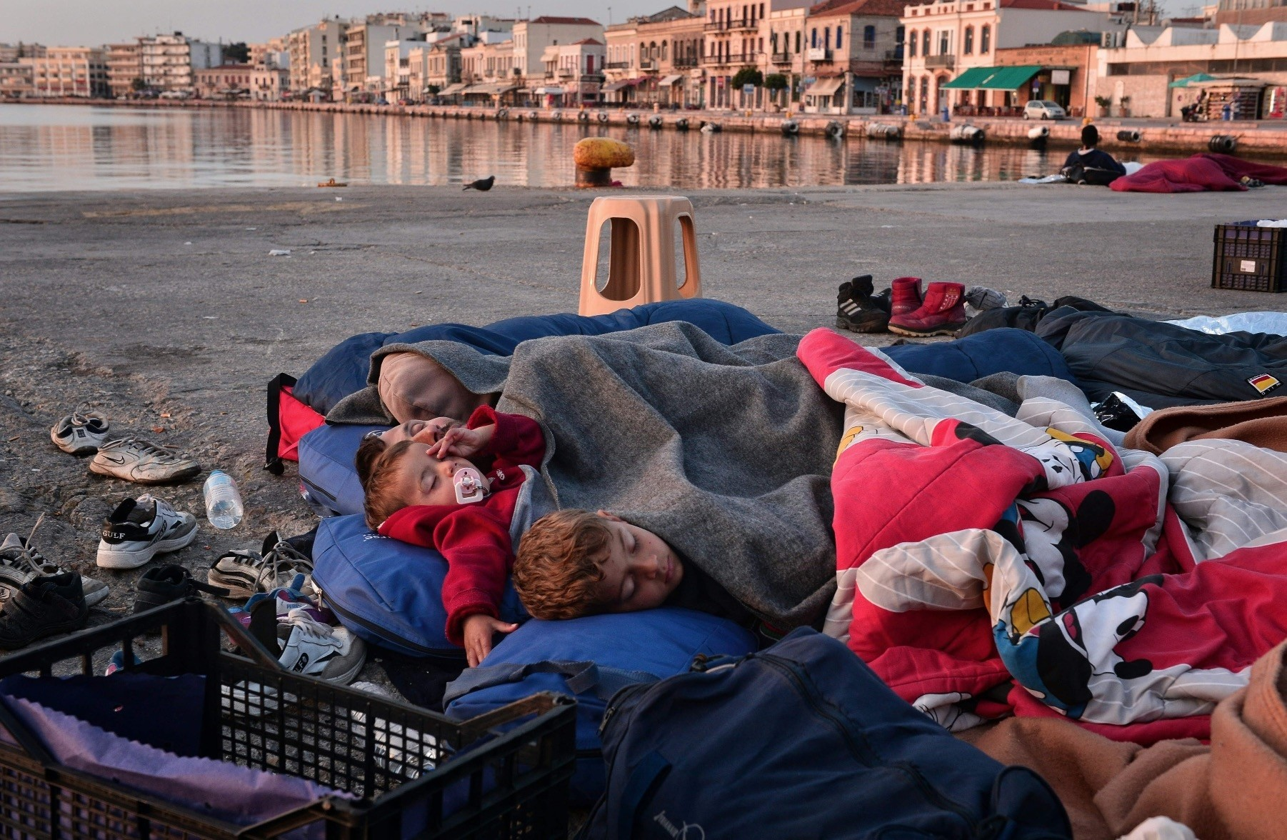 Children sleep at the Port of Chios, Greece, April 5, 2016