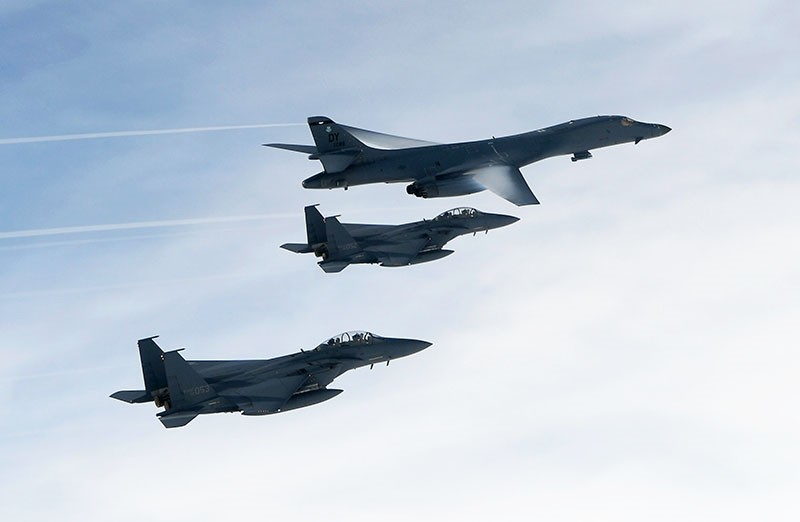 This handout photo taken on July 8, 2017 and provided by the South Korean Defence Ministry in Seoul shows the B-1B Lancer (top) flying over South Korea during a South Korea-US joint live fire drill conducted at a range in Yeongwol County. (AFP Photo)