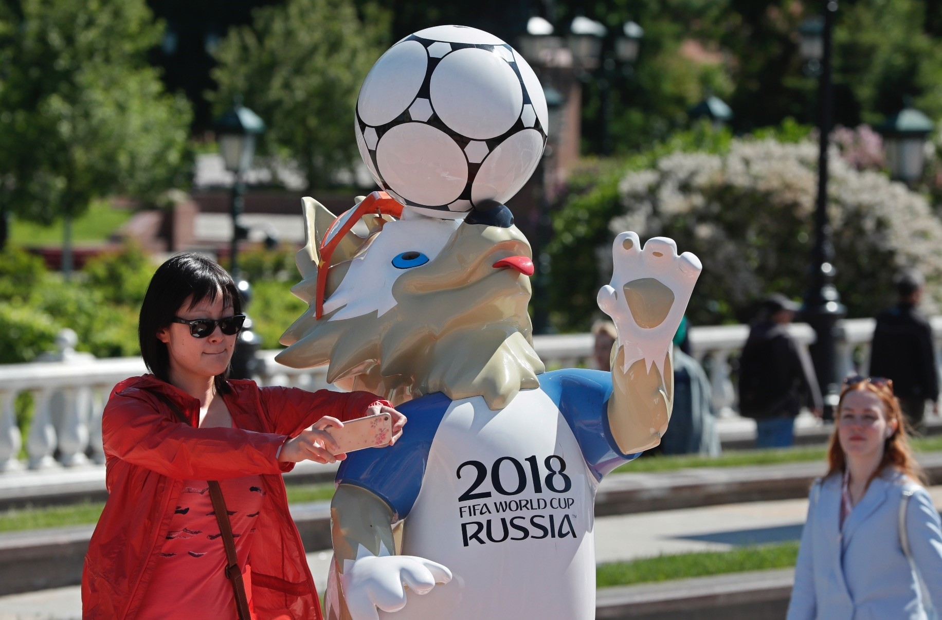 A woman takes a selfie with a sculpture of Zabivaka, the official mascot for the 2018 FIFA World Cup Russia, Moscow, Russia, May 21.