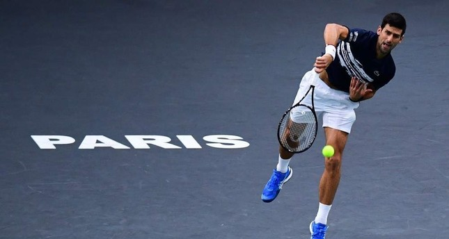 Serbia's Novak Djokovic returns the ball to Canada's Denis Shapovalov during their men's singles final tennis match at the ATP World Tour Masters 1000 - Rolex Paris Masters - indoor tennis tournament at The AccorHotels Arena in Paris on November 3, 2019. Photo by MARTIN BUREAU / AFP