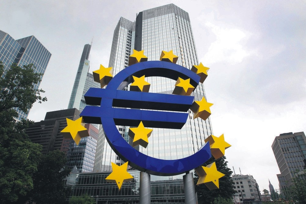 A huge logo of the Euro currency in front of the former headquarters of the European Central Bank in Frankfurt, Germany.