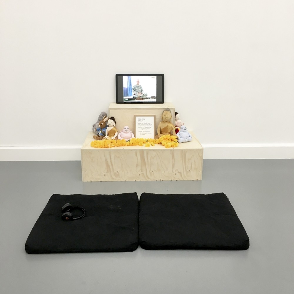 In her work u201cAmerican Buddhistu201d (2016) Jafri focuses on meditation sessions of American Buddhist soldiers. Jafri uses single-channel video, some Buddha pillows around screen. To watch the video you sit on pillows and u201cparticipateu201d in the meditation.