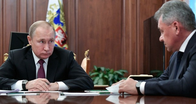 In this Feb. 2, 2019, file photo, Russian President Vladimir Putin, left, speaks to Defense Minister Sergei Shoigu during a meeting in the Kremlin in Moscow, Russia. AP Photo