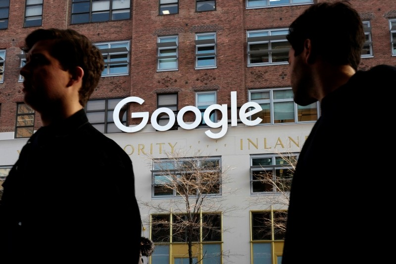 In this Dec. 4, 2017, file photo, people walk by Google offices in New York. (AP Photo)
