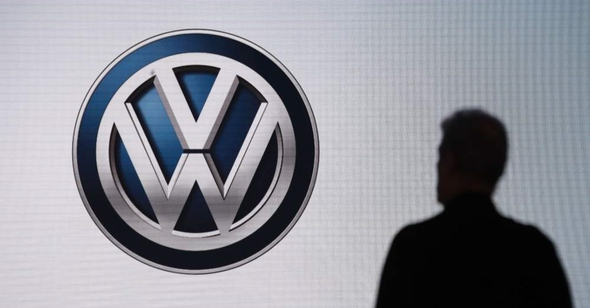 In this Wednesday, Nov. 28, 2018, file photo an attendee waits for the start of a news conference at the Volkswagen booth at the Los Angeles Auto Show in Los Angeles. (AP Photo)