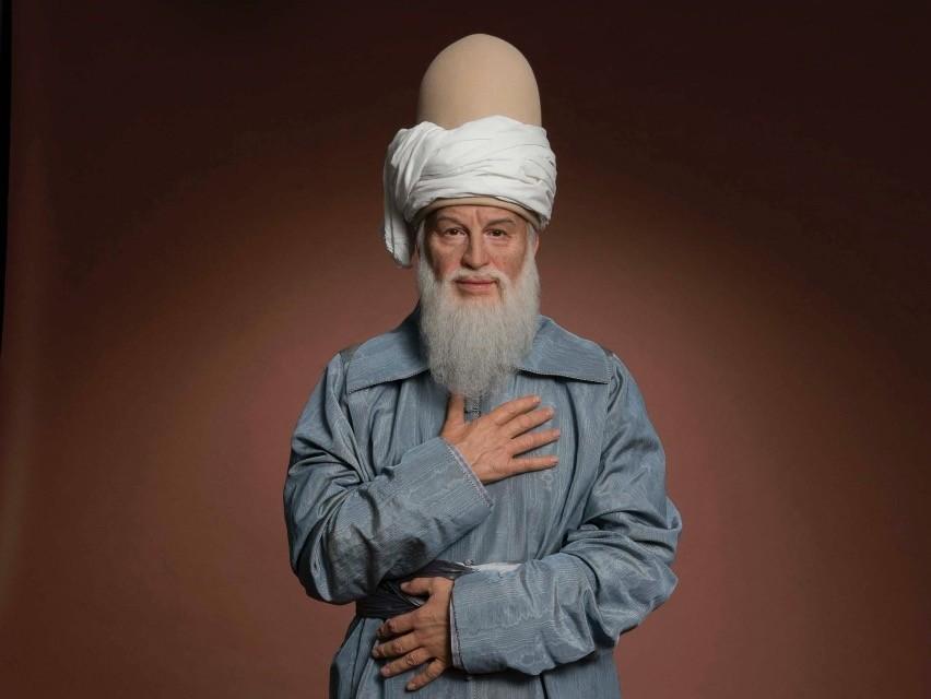 Wax sculpture of Rumi at Madame Tussauds.