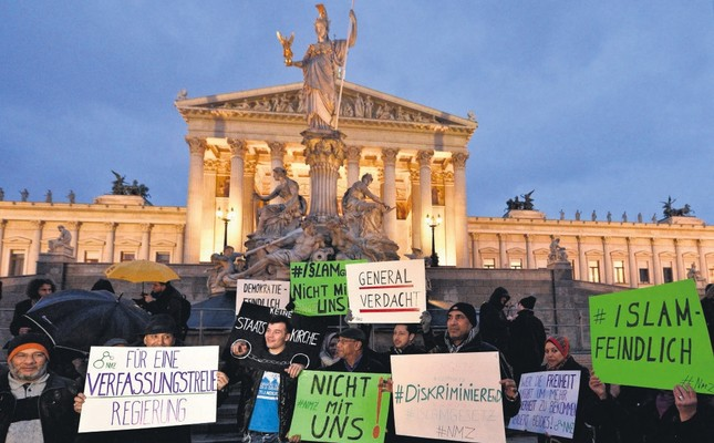 Protesters hold banners during a demonstration organized under the slogan New Islam Law? Not with us! in front of the parliament building in Vienna, Austria, Feb. 24, 2015.