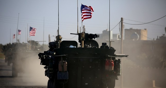 A convoy of U.S. forces armoured vehicles drives on the outskirts of Manbij city, on March 5, 2017. The U.S. sent latest batch of deliveries to YPG-held areas on Monday.