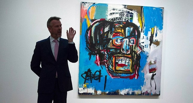 This file photo taken on May 5, 2017 shows a Sotheby's official speaking about Untitled, a 1982 painting by Jean-Michel Basquiat during a media preview at Sotheby's in New York. (AFP Photo)