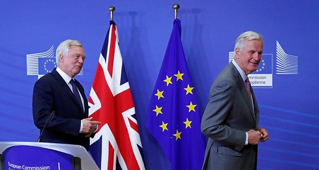 UK Secretary of State for Exiting the European Union David Davis (L) is welcomed by the European Commission's Chief Brexit Negotiator Michel Barnier at the start of Brexit talks in Brussels, Belgium July 17, 2017. (Reuters Photo)