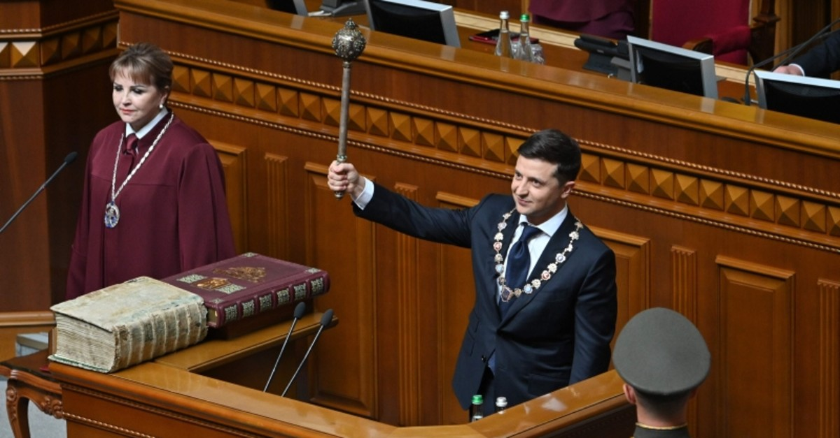 Ukraine's President Volodymyr Zelensky holds Bulava, the Ukrainian symbol of power, during his inauguration ceremony at the parliament in Kiev on May 20, 2019. (AFP Photo)
