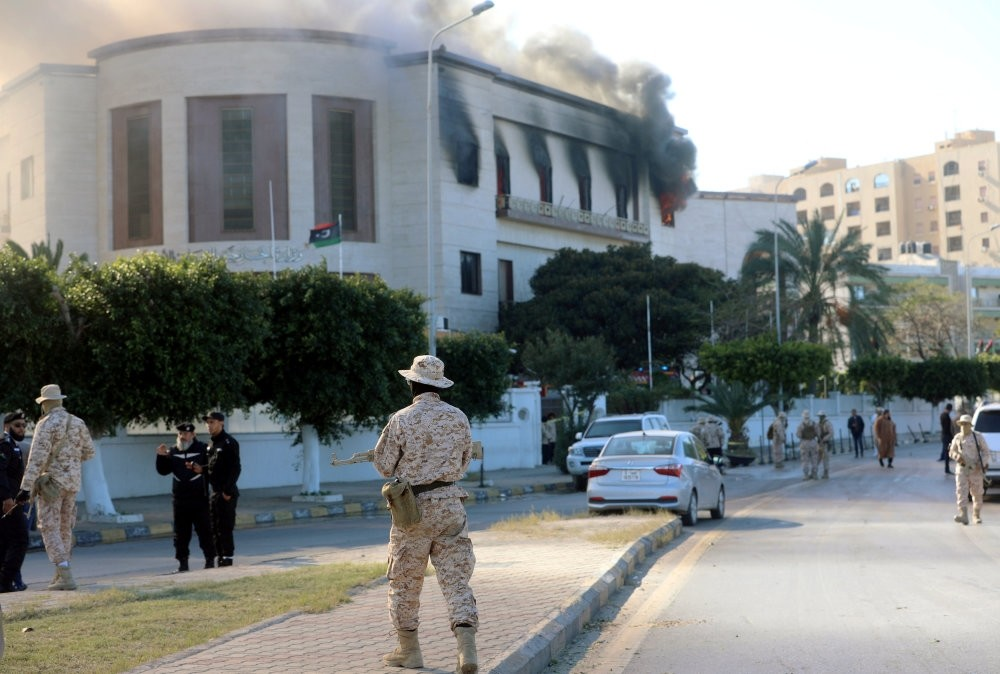 Security forces stand around the headquarters of Libyau2019s Foreign Ministry after a suicide attack, Tripoli, Dec. 25, 2018.
