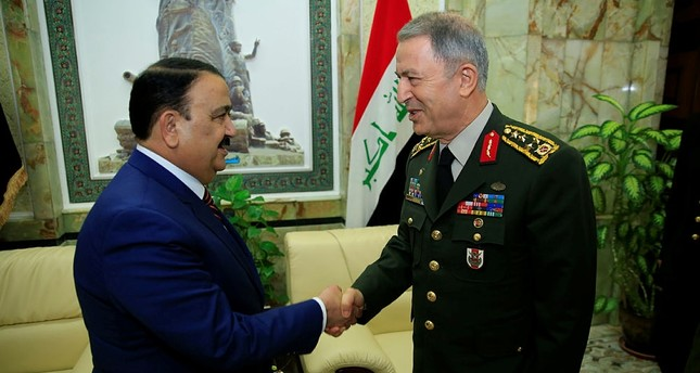 Iraqi Defense Minister Irfanal-Hayali and Turkish Chief of General Staff Akar meet in Baghdad on March 1, 2018. (AA Photo)