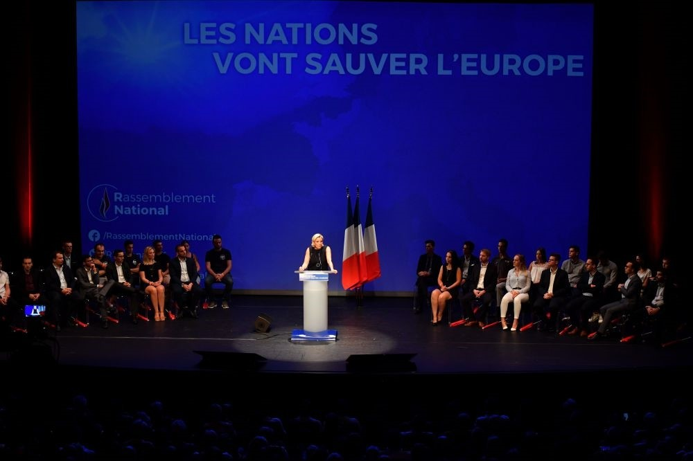France's far-right leader Marine Le Pen (C) delivers a speech at a meeting, Fru00e9jus, Sept. 16.