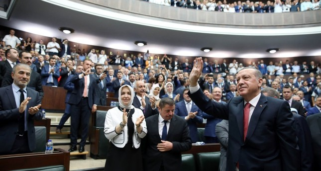 President Recep Tayyip Erdoğan wave during the AK Party's group meeting in Parliament, Ankara, July 25.