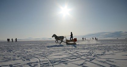 pLake Çıldır in northeastern Ardahan province has frozen over, drawing thousands of locals and visitors to enjoy horse-drawn sledding, Eskimo fishing and cookouts on its icy surface./p  pThe...