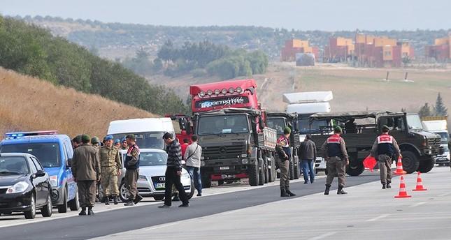 Trucks belonging to Turkey's intelligence agency were stopped on a road in the southern city of Adana on Jan. 19, 2014.
