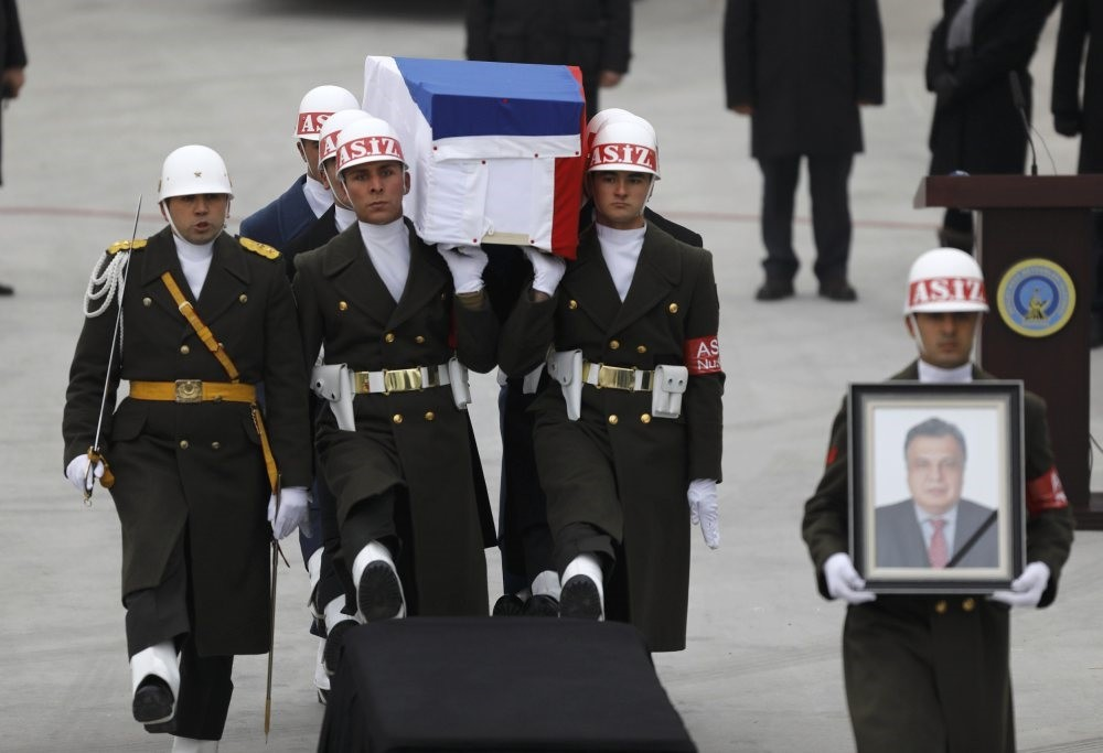 Turkish soldiers carry Andrey Karlov's coffin to a plane that would take his body to Russia on Dec. 20, 2016.