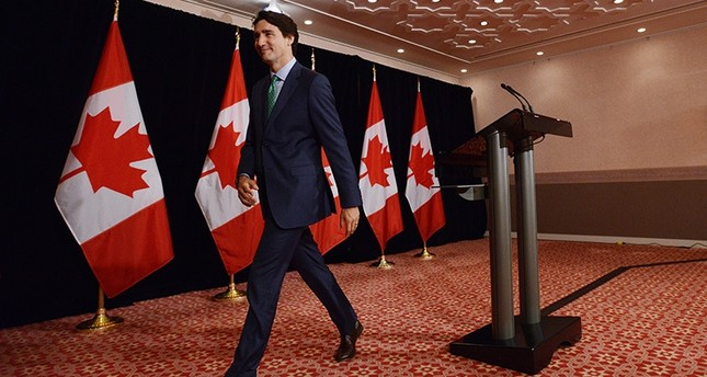 Canada Prime Minister Justin Trudeau leaves after holding a press conference in Shima, Japan on Friday, May 27, 2016., following the G7 Summit. (AP Photo)