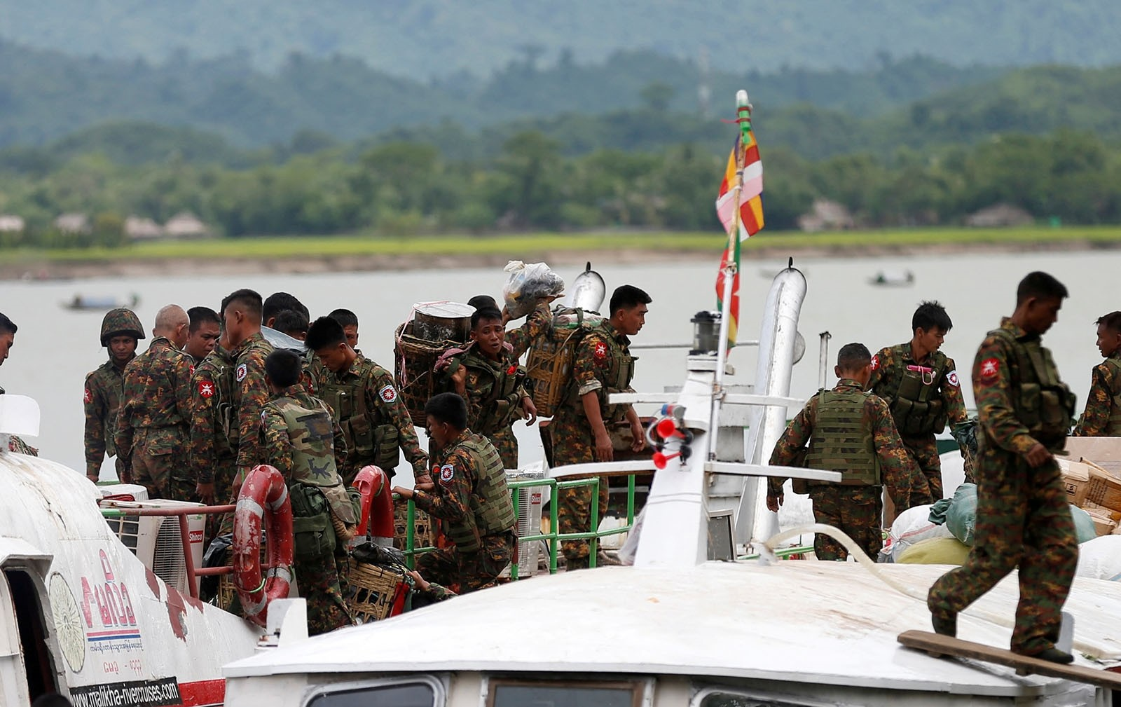 Myanmar soldiers arrive at Buthidaung jetty after the Arakan Rohingya Salvation Army's (ARSA) attacks, at Buthidaung, Myanmar August 29, 2017.