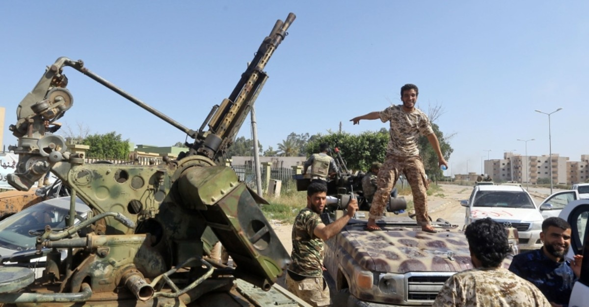 Forces loyal to Libya's Government of National Accord (GNA) gesture on April 18, 2019, after taking control of the area of al-Aziziyah, located some 40 kilometres south of the Libyan capital Tripoli. (AFP Photo)