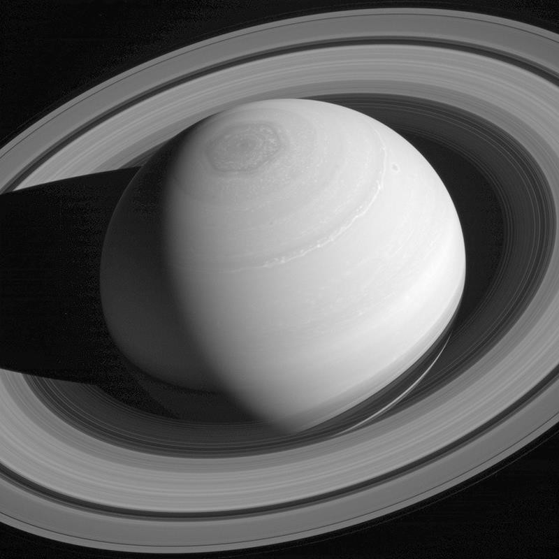This May 4, 2014 image made available by NASA shows the persistent hexagonal cloud pattern on Saturn's north pole, as seen from the Cassini spacecraft.