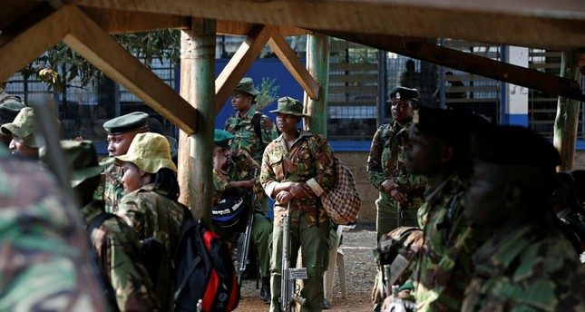 Kenyan security personnel wait at a tallying center before being assigned to polling stations, in Nairobi, Kenya August 7, 2017. REUTERS Photo