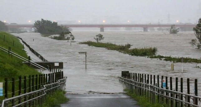 Swollen water levels along Tama river are pictured after heavy rains brought by approaching Typhoon Hagibis hit the Tokyo area on October 12, 2019 (AP Photo)