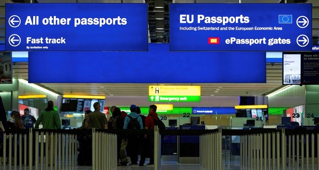 A general view of the UK Border crossing in the new Terminal 2 at Heathrow Airport in London, Britain, 04 June 2014. (EPA Photo)