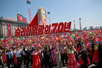 North Korea holds back missiles, puts economy first in parade to mark 70th anniversary