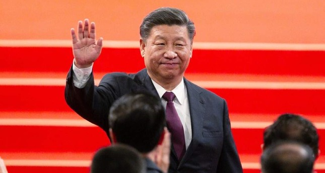 Chinese President Xi Jinping waves during an inauguration ceremony to mark the 20th anniversary of the former Portuguese colony's handover to Chinese rule, Macao, Dec. 20, 2019. (AP Photo)