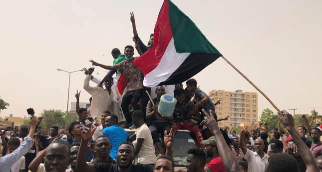 Sudanese shout slogans during a demonstration against the military council, in Khartoum, Sudan, Sunday, June 30, 2019. (AP Photo)