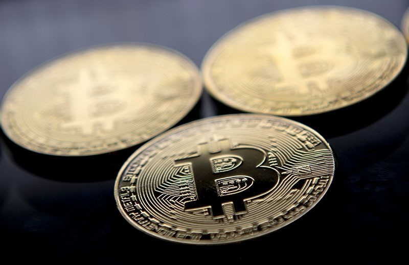 This file photo taken on November 20, 2017 shows gold plated souvenir Bitcoin coins arranged for a photograph in London. (AFP Photo)