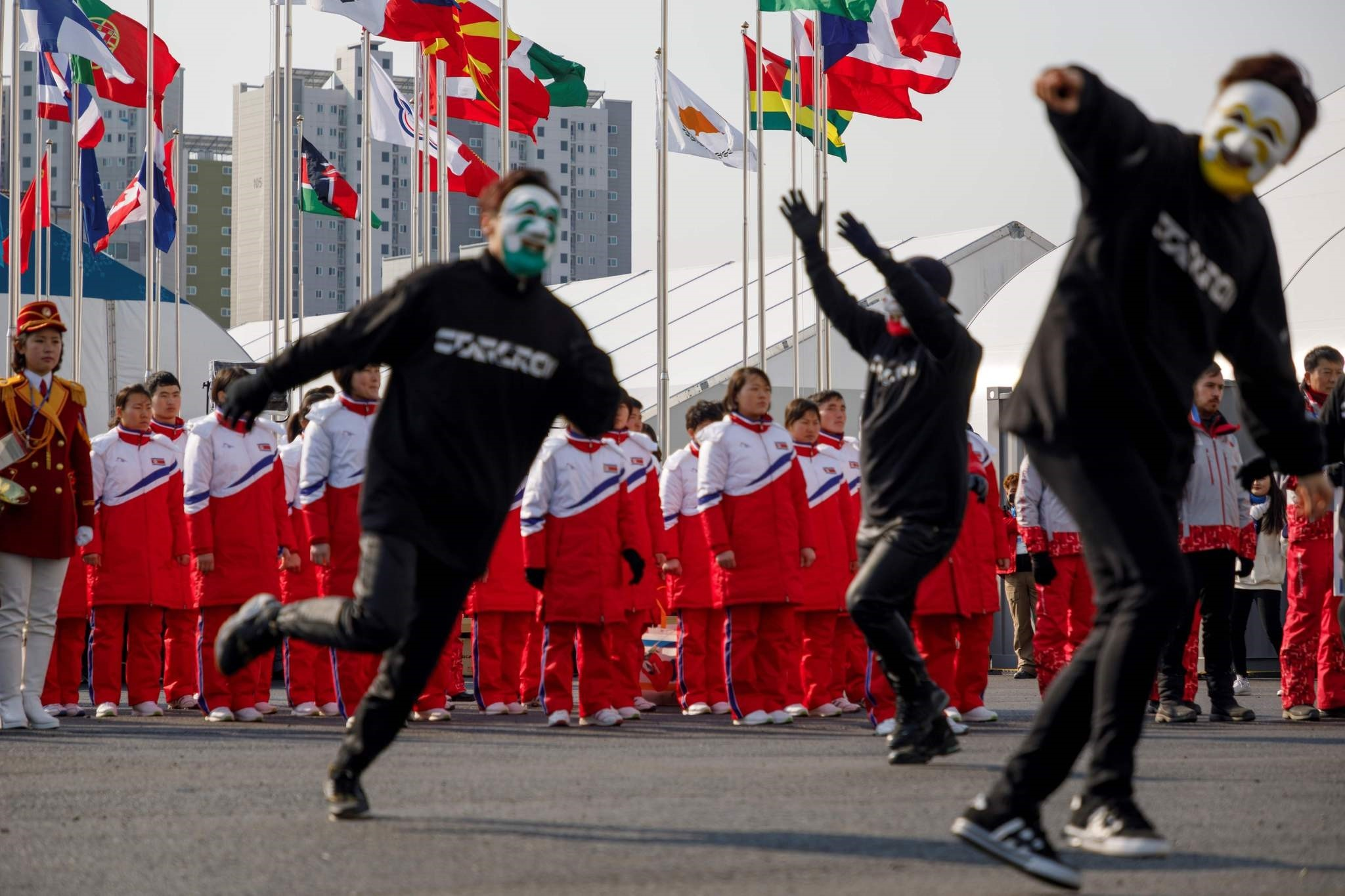 North Korea's athletes watch as South Korean B-Boys perform a dance routine at a welcoming ceremony at the athletes village ahead of the 2018 Pyeongchang winter Olympic games in Gangneung on February 8, 2018. (AFP PHOTO)