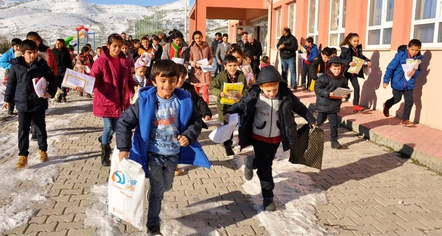 Students leave school premises after receiving their report cards at an elementary school in Arguvan district, Malatya, eastern Turkey. (IHA Photo)