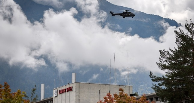 A Super Puma helicopter of the Swiss Air Force flight above the Spiez Laboratory, Swiss Federal Institute for NBC-Protection (nuclear, biological, chemical) on September 14, 2018 in Spiez, 40km from Swiss capital Bern. (AFP Photo)
