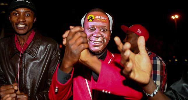 Supporters of Kenya's President Uhuru Kenyatta celebrate ahead of election results announcement in Nairobi, Kenya August 11, 2017. (Reuters Photo)