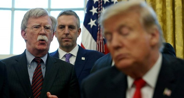 U.S. President Donald Trump listens as his national security adviser John Bolton speaks during a presidential memorandum signing for the Women's Global Development and Prosperity initiative in the Oval Office at the White House in Washington, Feb. 7, 2019. Reuters Photo