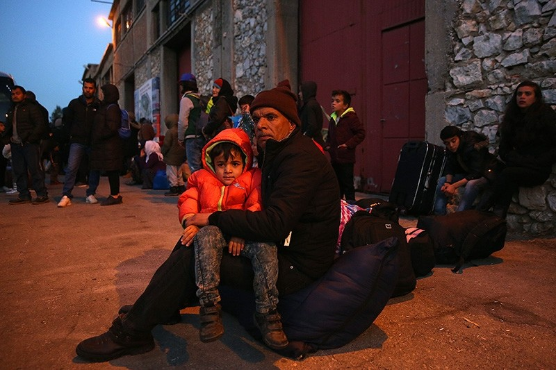 Refugees wait for transport after they arrived on the ferry 'Nissos Samos' from Lesvos island at the port of Piraeus, Greece, 11 December 2017. (EPA Photo)