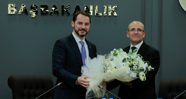 New Treasury and Finance Minister Berat Albayrak (L) and former Deputy Prime Minister Mehmet Şimşek. (AA Photo)