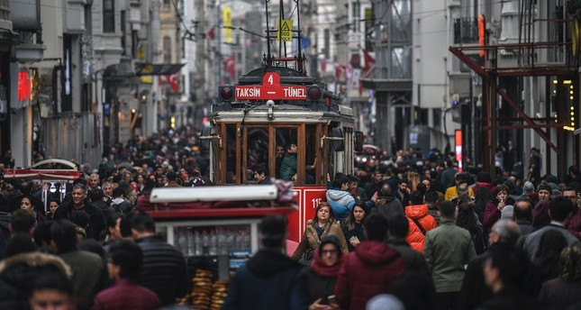 A tramway drives through a crowd in İstiklal Avenue, Istanbul, Jan. 25, 2019. The happiness rate dropped in the country last year though hopes for a better future prevail according to a TurkStat survey.