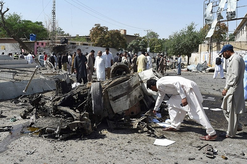 Pakistani security officials inspect the site of a powerful explosion that targeted a police vehicle in Quetta on June 23, 2017. (AFP Photo)