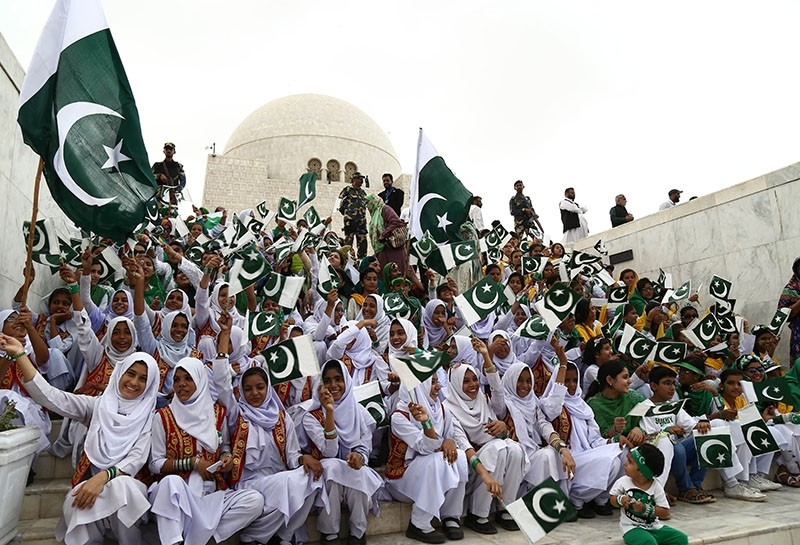 Pakistani girls attend a ceremony at the mausoleum of founder of Pakistan, Muhammad Ali Jinnah, as national celebrates the Independence Day, in Karachi, Pakistan, Aug. 14, 2017. (EPA Photo)