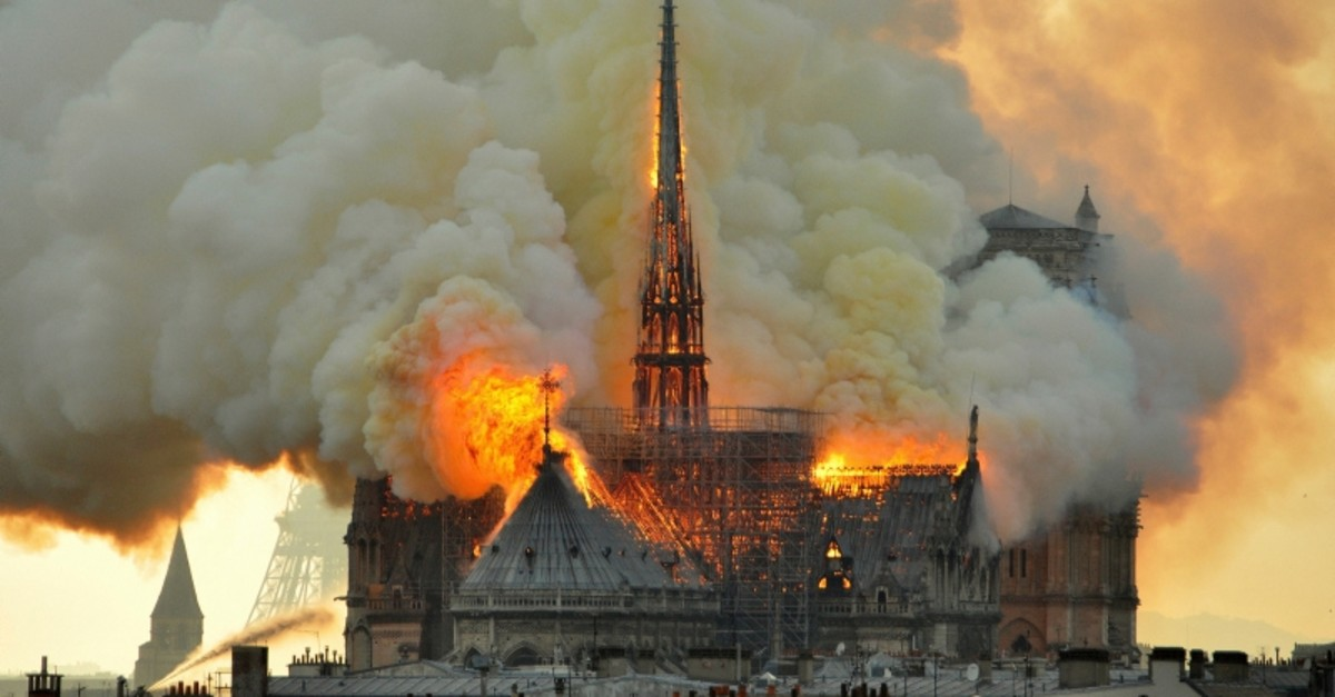In this image made available on Tuesday April 16, 2019 flames and smoke rise from the blaze at Notre Dame cathedral in Paris, Monday, April 15, 2019. (AP File Photo)