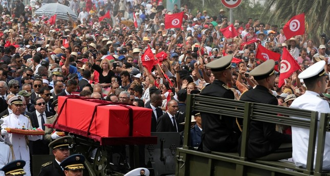 Military officers escort the coffin of late Tunisian President Beji Caid Essebsi during his funeral in Tunis, Tunisia, July 27, 2019.