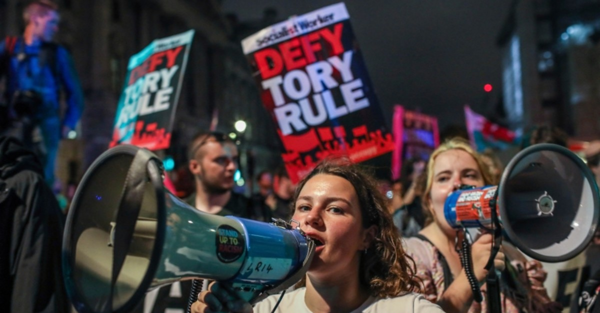 Protesters outside the House of Commons, London, Tuesday, Sept. 3, 2019. (AP Photo)