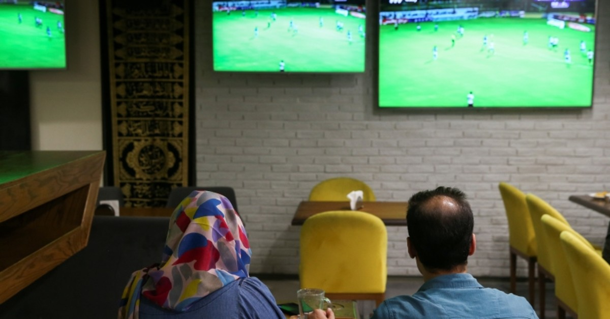 An Iranian woman watch a football match with her friend at a cafe in Tehran, Iran September 15, 2019. Picture taken September 15, 2019 (Reuters Photo)